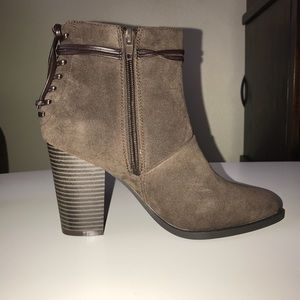 Casual-chic booties with corsetry in the back!